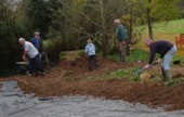 Volunteers help with digging